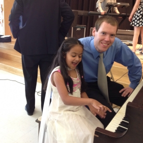 James Woolwine with his piano student Anaggha
